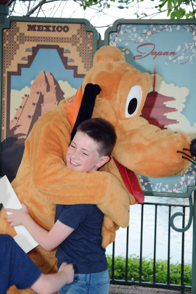 hugs from Pluto at EPCOT