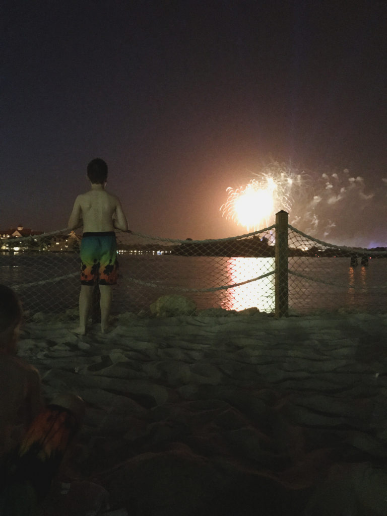 watching Magic Kingdom Fireworks from the beach at Disney's Polynesian Village Resort