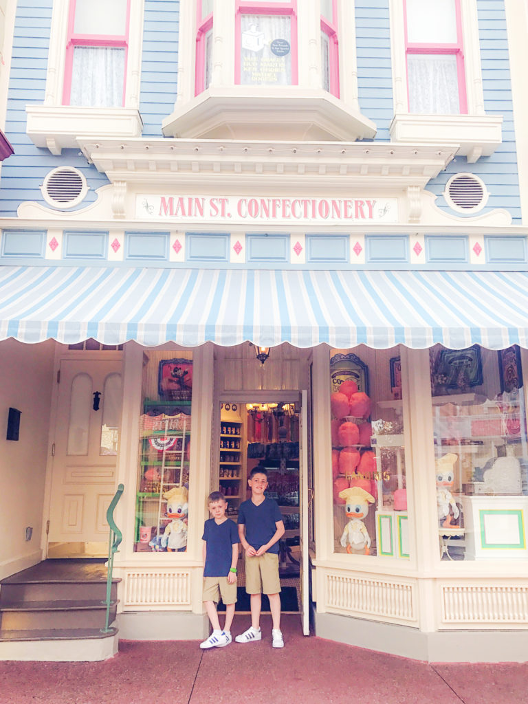 the boys loved looking in all the cool shops on Main Street USA and insisted I take their picture in front of each one