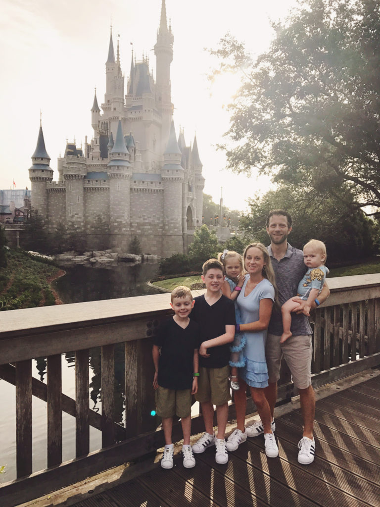 family picture in front of cinderella castle