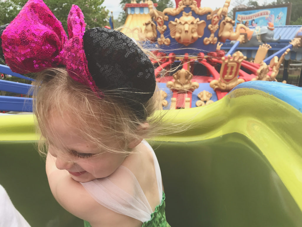 Eloise riding Dumbo at magic kingdom