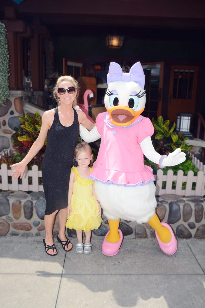 posing with Daisy Duck at Hollywood Studios