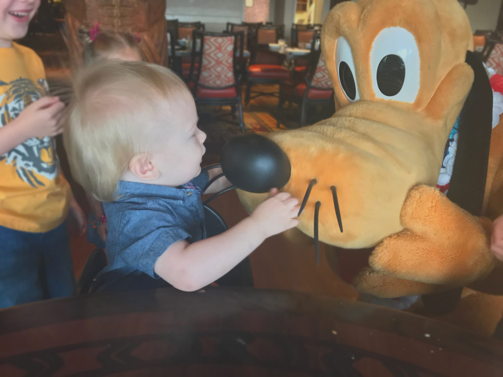 Liam meeting Pluto at Ohana Character breakfast