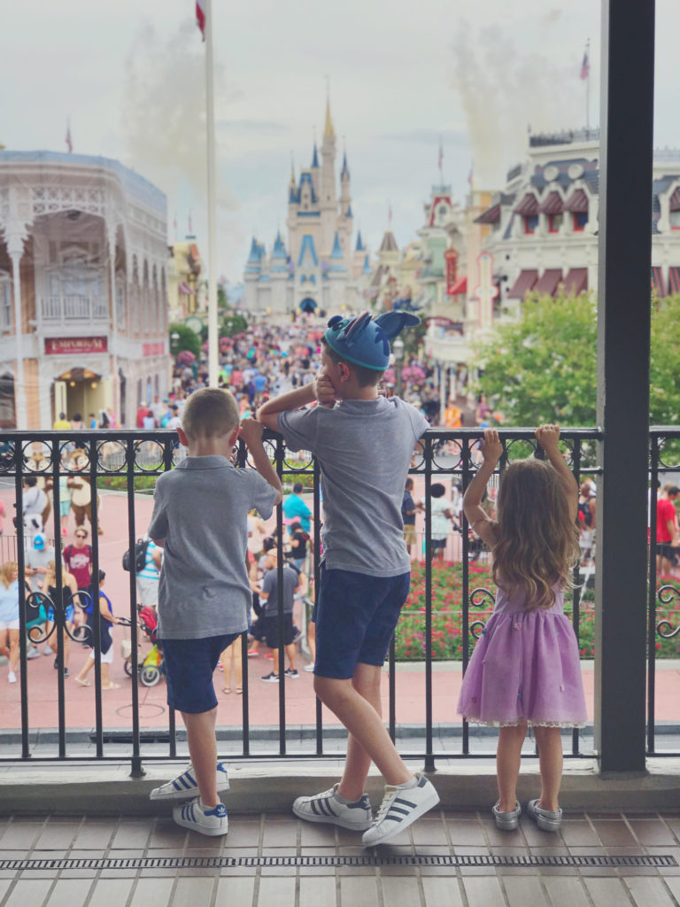 kids saying goodbye to Magic Kingdom on main street railroad platform